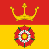 Hampshire flag: divided horizontally, a Tudor rose in white and red on yellow, below a gold coronet on red